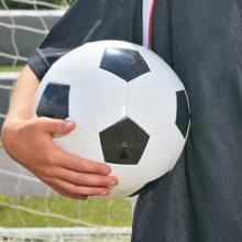 Soccerball under an arm